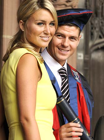 Gerrard and his wife Alex Curran pose for photographers before receiving his Honorary Fellowship degree from Liverpool University