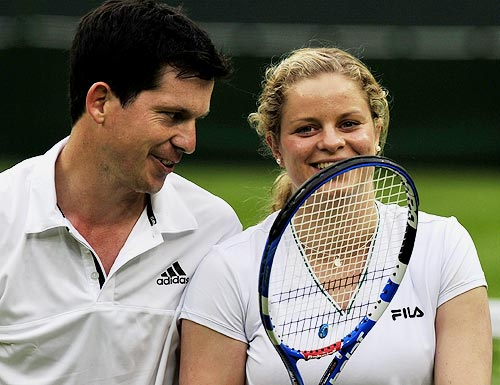 Kim Clijsters smiles with partner Tim Henman during the mixed doubles match