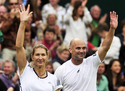 Steffi Graf and Andre Agassi wave to the crowd