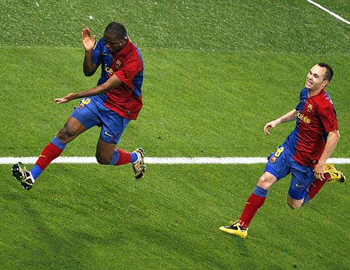 Samuel Eto'o (left) celebrates with Andres Iniesta after scoring the first goal