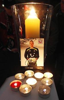 Fans light candles in memory of Robert Enke outside the headquarters of Bundesliga team Hanover 96