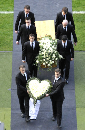 Pall bearers carry the coffin of late goalkeeper Robert Enke during a memorial service on Sunday