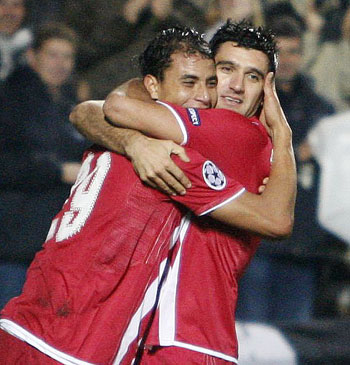 Girondins Bordeaux' Fernando celebrates with his teammate Marouane Chamakh after scoring against Juventus