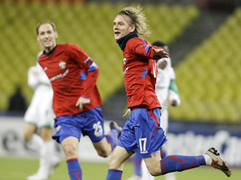 CSKA Moscow's Milos Krasic and Rahimic celebrate a goal against VfL Wolfsburg