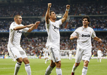 Real Madrid's Ronaldo celebrates his goal with his teammates Benzema and Kaka