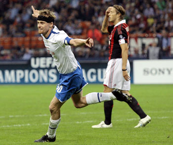 FC Zurich's Hannu Tihinen celebrates after scoring against AC Milan
