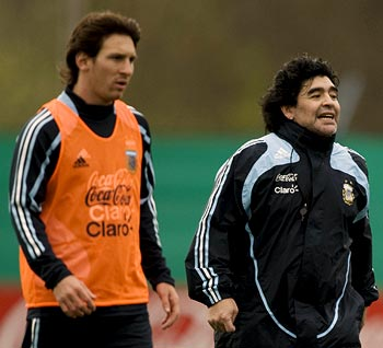 Diego Maradona (right) with Lionel Messi