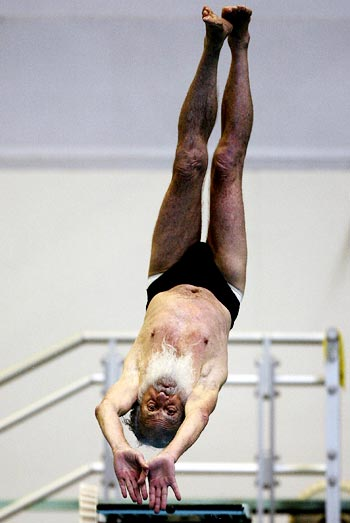 An 80-year-old competitor from Australia who goes by the name Santa Claus dives from the 1 metre springboard