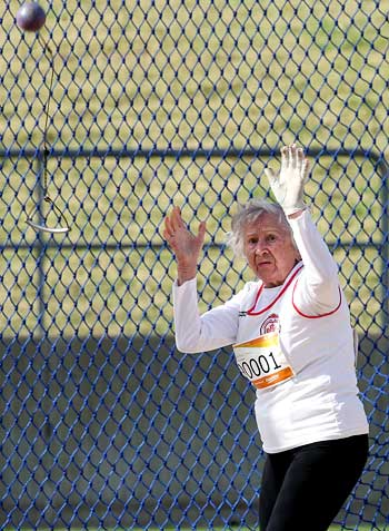 Olga Kotelko, 90, from Canada competes in the women's hammer throw