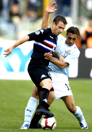 Sampdoria's Cassano and Lazio's Siviglia vie for possesion during their Serie A match in Rome on Sunday