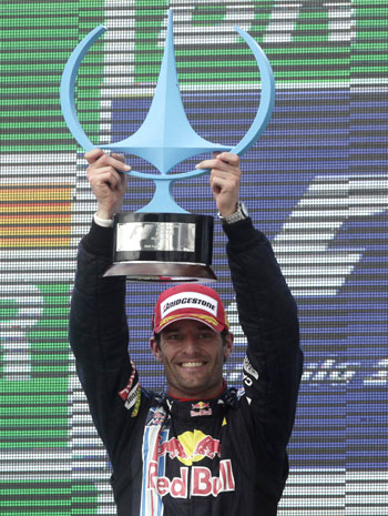 Mark Webber celebrates after a podium finish at the Brazilian GP