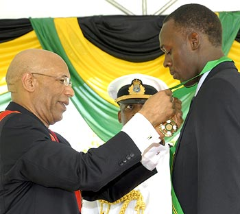 Usain Bolt receives the Order of Jamaica from Jamaica's Governor General Patrick Allen