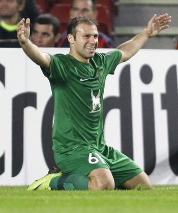 Rubin Kazan's Karadeniz celebrates his goal against FC Barcelona