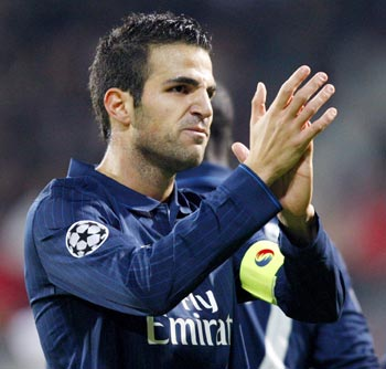 Arsenal's Fabregas celebrates after scoring against AZ Alkmaar