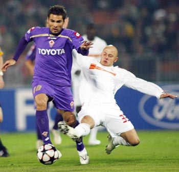 Varga of Debreceni challenges Mutu of Fiorentina during their UEFA Champions League soccer match in Budapest