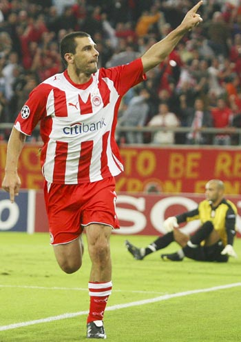 Olympiakos Piraeus' Ieroklis Stoltidis celebrates after scoring against Standard Liege