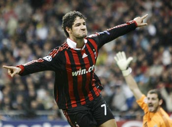 AC Milan's Pato celebrates his goal as Real Madrid's goalkeeper Casillas reacts during their Champions League match