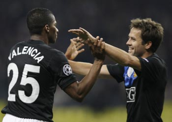 Manchester United's Antonio Valencia and Michael Owen celebrate after scoring a goal against CSKA Moscow