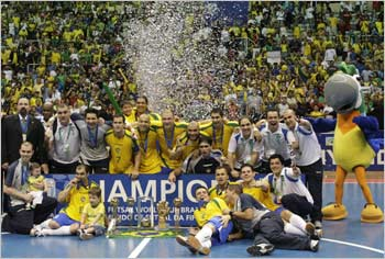 Brazil's players celebrate after winning the FIFA Futsal World Cup final soccer match in Rio