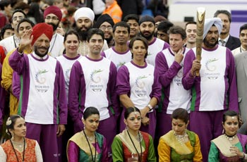 Athletes stand outside Buckingham Palace during the launch of the 2010 CW Games baton relay
