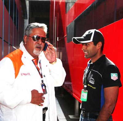 Karun Chandhok (right) with Force India owner Dr Vijay Mallya
