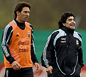Messi and Maradona in training