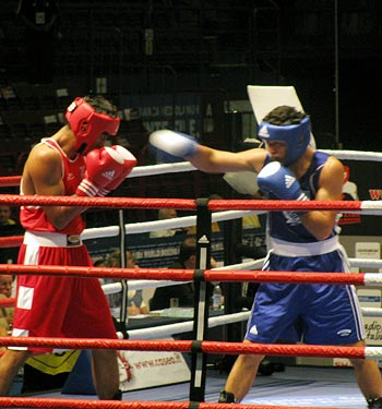 Vijender Singh (left) in action against Kazakhstan's Azamat Belgibayev