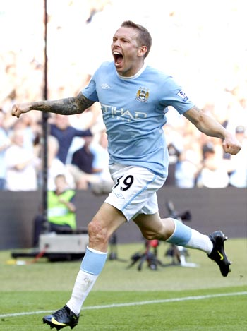 Manchester City's Craig Bellamy celebrates after scoring against Arsenal