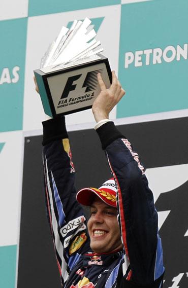 Sebastian Vettel with the trophy