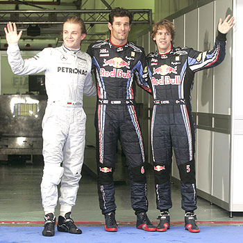 Mark Webber (centre), Nico Rosberg (left) and Sebastian Vettel