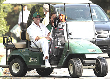 Steve Williams, caddie of Tiger Woods, watches as Woods playes a practice round in Augusta