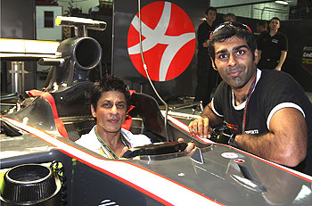 shah rukh khan with karun chandhok at the sepang circuit