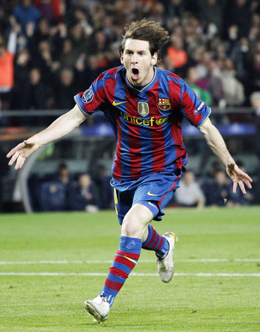 Lionel Messi celebrates after scoring a goal