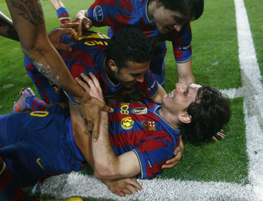 Lionel Messi celebrates with team-mates