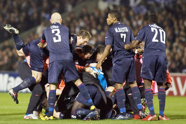 Lyon players celebrate after the match