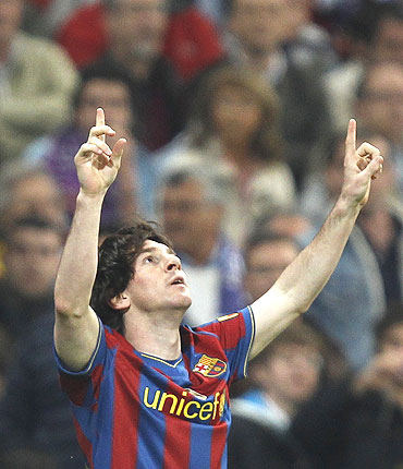 Lionel Messi celebrates after scoring against Real Madrid