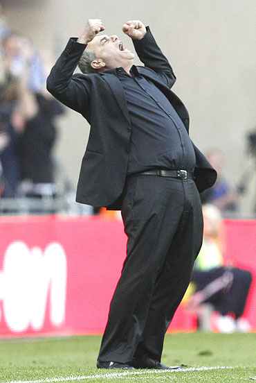 Portsmouth's manager Avram Grant is overjoyed after their FA Cup semi-final win over Tottenham Hotspur