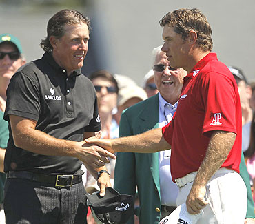 Lee Westwood (right) congratulates Phil Mickelson