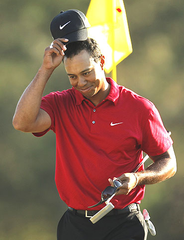 Tiger Woods acknowledges the crowd after finishing his final round of play
