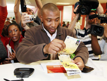 Mithethwa Sibusiso of South Africa shows his tickets as he is the first person who obtained World Cup tickets