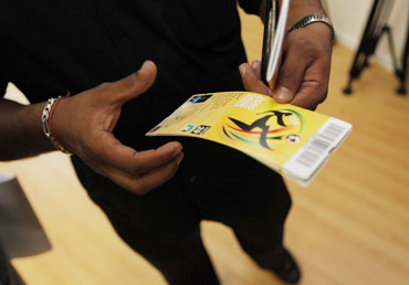 A fan holds tickets as the final round of sales begins