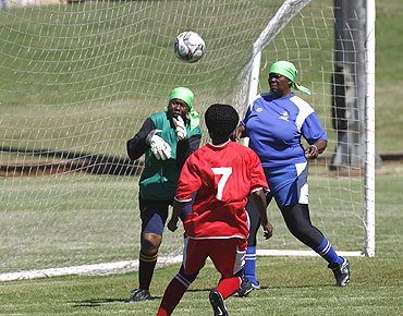 Members of Vakhegula Vakhegula Football Club play a practice match against Metro Rail Eagles team at Esselen Park in Johannesburg