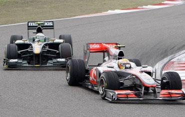 Lewis Hamilton ahead off Red Bull's Heikki Kovalainen