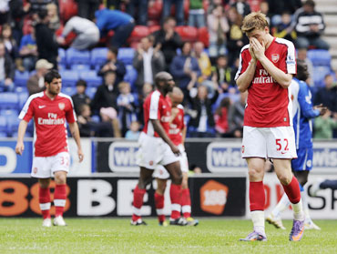 Arsenal players react after losing the match