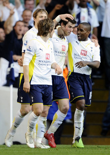 Gareth Bale celebrates with team-mates after scoring