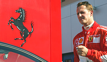 Michael Schumacher enters the Ferrari paddock in 2006
