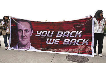 Fans of Schumacher hold a banner at the Chinese F1 Grand Prix in Shanghai on Sunday