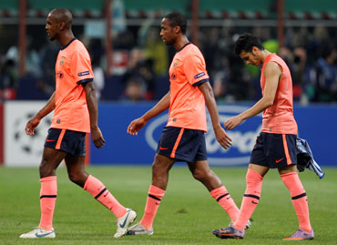 Barcelona players walk off the pitch after the match