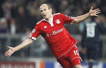 Arjen Robben celebrates after scoring