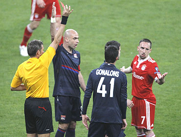 Franck Ribery (right) is shown the red card by referee Roberto Rosetti (left)